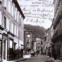 Carte postale de Mazamet : la Grand-Rue. A gauche, l'imprimerie Carayol